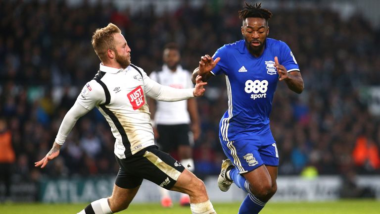 Johnny Russell and Jaques Maghoma vie for possession at the iPro Stadium