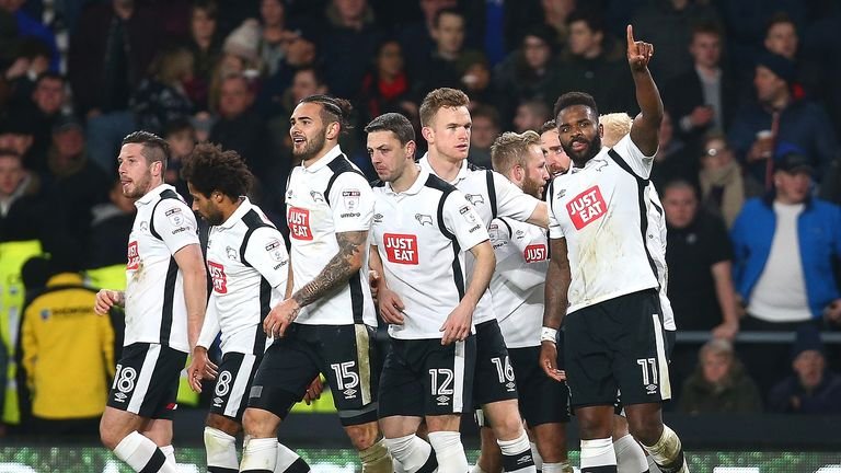 Darren Bent celebrates with his Derby team-mates after putting them ahead in the match against Brimingham