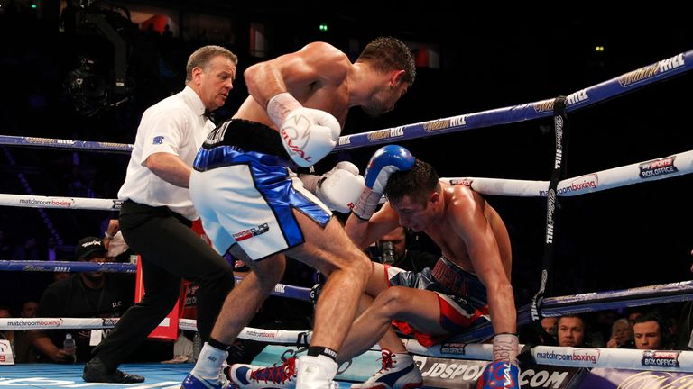 Burton falls to the canvas late on after an assault from Buglioni