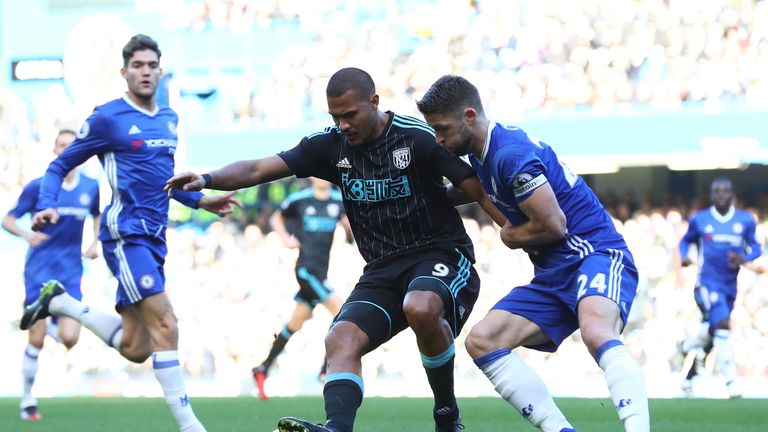 Salomon Rondon of West Bromwich Albion controls the ball under pressure of Gary Cahill of Chelsea