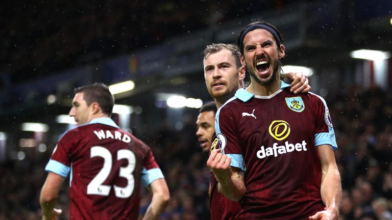 George Boyd (R) celebrates after scoring Burnley's third goal against Bournemouth