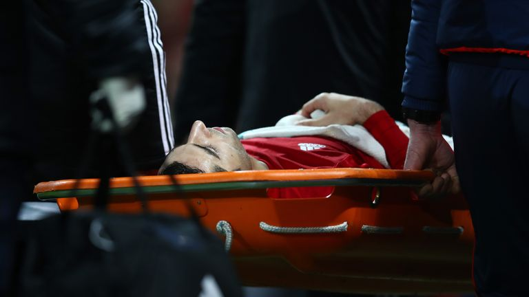 MANCHESTER, ENGLAND - DECEMBER 11:  Henrikh Mkhitaryan of Manchester United is taken off by a stretcher after the challenge by Danny Rose of Tottenham Hots