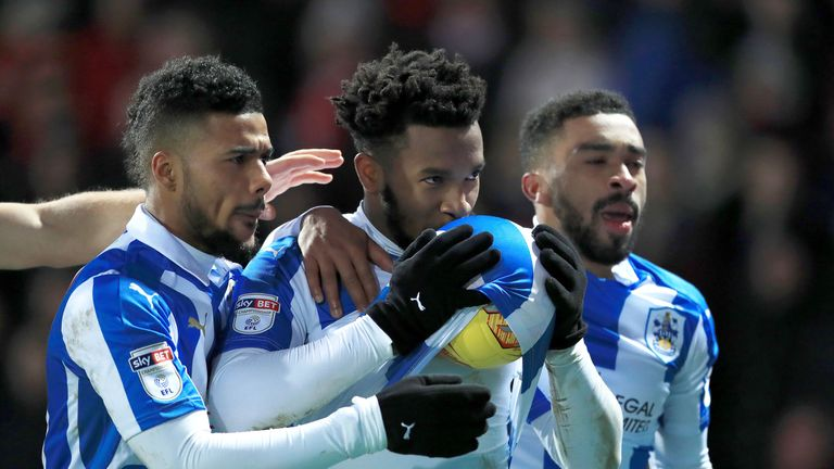 Huddersfield Town's Kasey Palmer (centre) celebrates scoring his side's first goal of the game