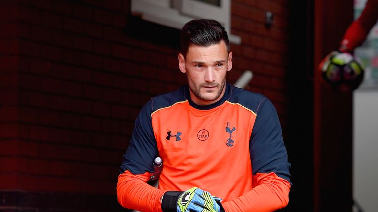 Hugo Lloris makes his way out to the pitch to warm up