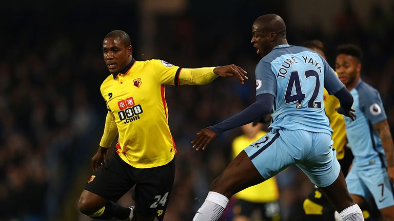 Odion Ighalo of Watford and Yaya Toure of Manchester City compete for the ball