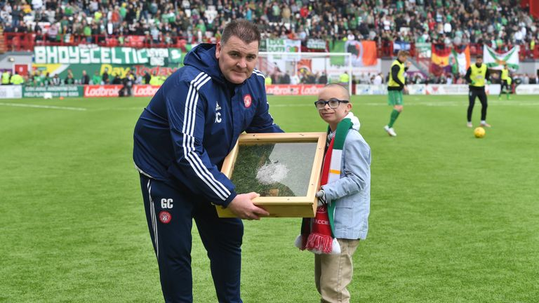 Hamilton coach George Cairns presents Jay Beatty with his goal of the season award