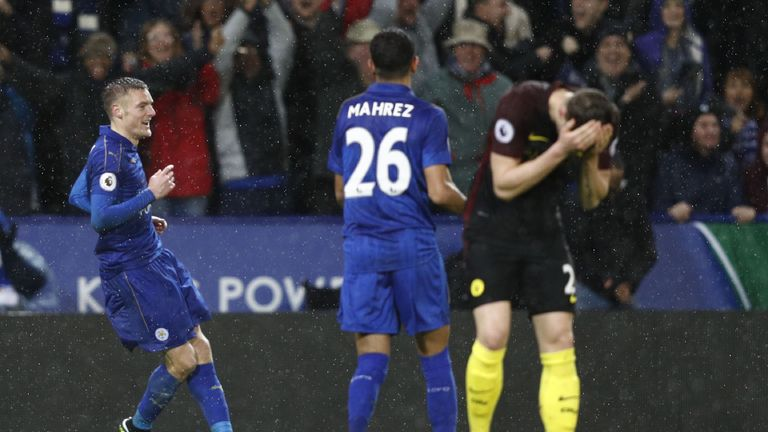 Jamie Vardy celebrates as John Stones reacts in the foreground