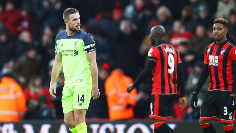 Liverpool skipper Jordan Henderson is dejected after the loss at Bournemouth