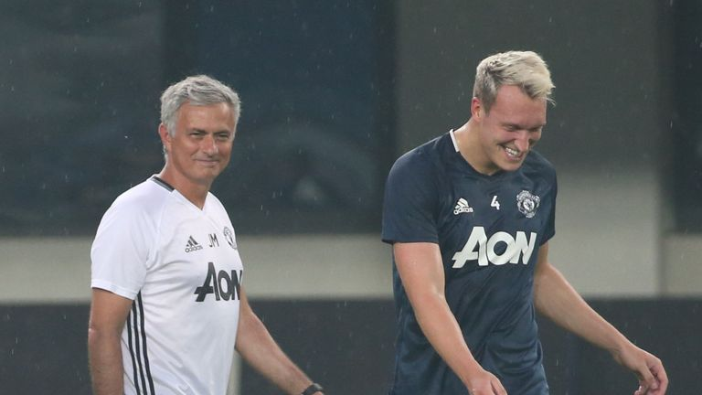Manager Jose Mourinho and Phil Jones of Manchester United