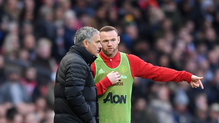 MANCHESTER, ENGLAND - NOVEMBER 19:  Jose Mourinho, Manager of Manchester United (L) speaks to Wayne Rooney of Manchester United (R)  during the Premier Lea