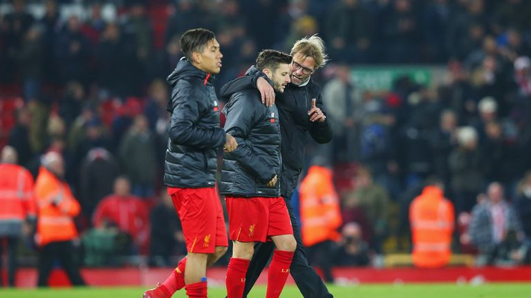 Jurgen Klopp in discussion with Adam Lallana after the 4-1 defeat of Stoke