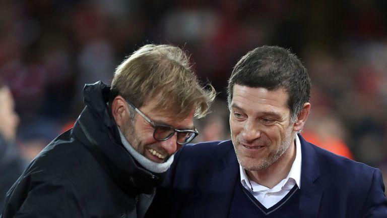 Liverpool boss Jurgen Klopp jokes with his West Ham counterpart Slaven Bilic