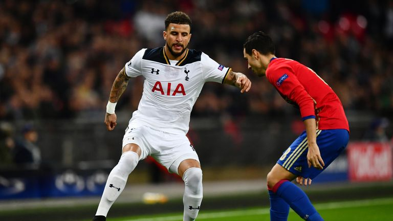Kyle Walker of Tottenham Hotspur (L) attempts to take the ball past Georgi Milanov of CSKA Moscow