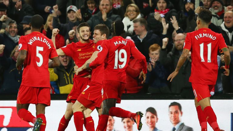 LIVERPOOL, ENGLAND - DECEMBER 11:  Adam Lallana (2nd L) of Liverpool celebrates scoring the opening goal with his team mates during the Premier League matc