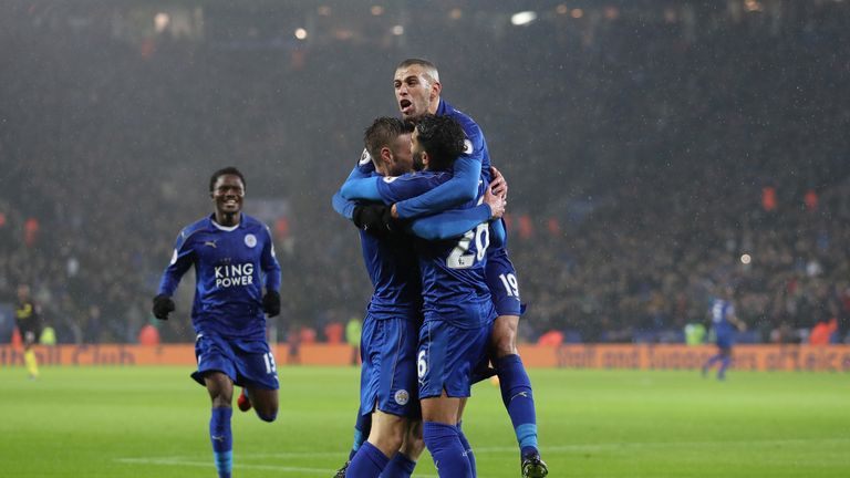 Jamie Vardy of Leicester celebrates scoring his side's third goal with Islam Slimani