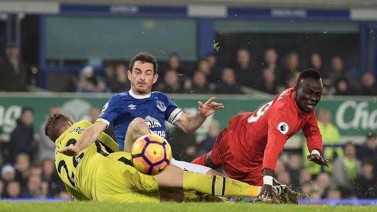 Leighton Baines collides with team-mate Maarten Stekelenburg under pressure form Sadio Mane