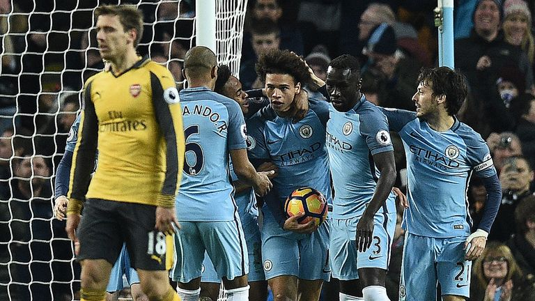 Leroy Sane (C) celebrates with his team-mates after equalising for Man City against Arsenal