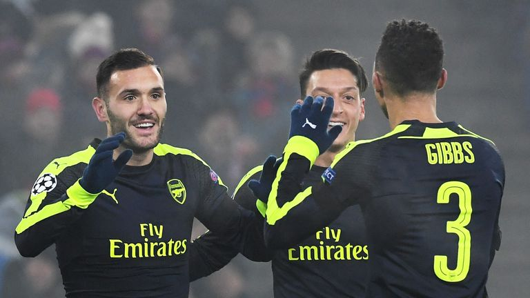 Arsenal forward Lucas Perez (L) scored a hat-trick for Arsenal