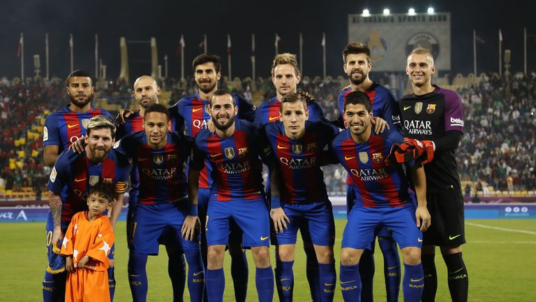 Afghan boy Murtaza Ahmadi poses for a picture with the FC Barcelona team