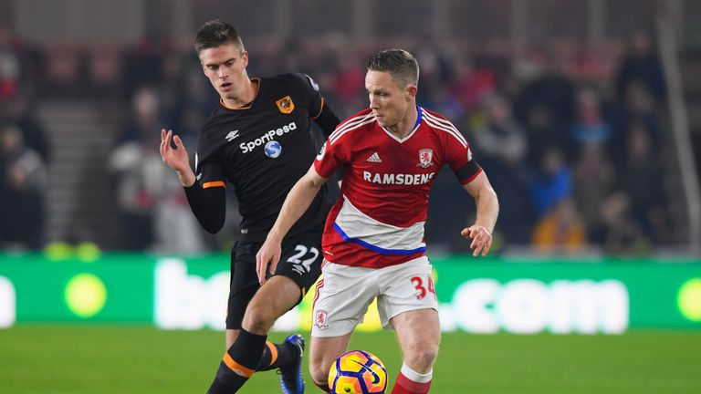 Adam Forshaw is chased by Markus Henriksen at the Riverside Stadium