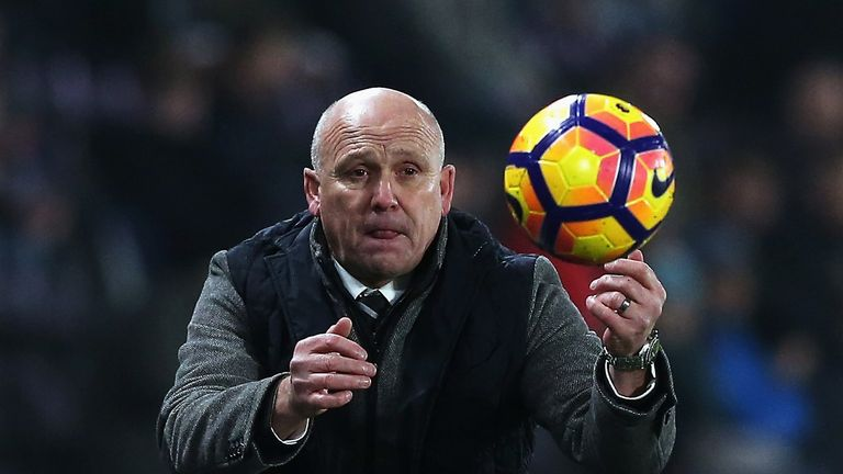 HULL, ENGLAND - DECEMBER 30:  Mike Phelan, Manager of Hull City throws the ball back during the Premier League match between Hull City and Everton at KCOM