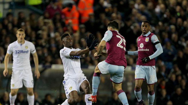 Aston Villa's Mile Jedinak challenges Leeds United's Hadi Sacko