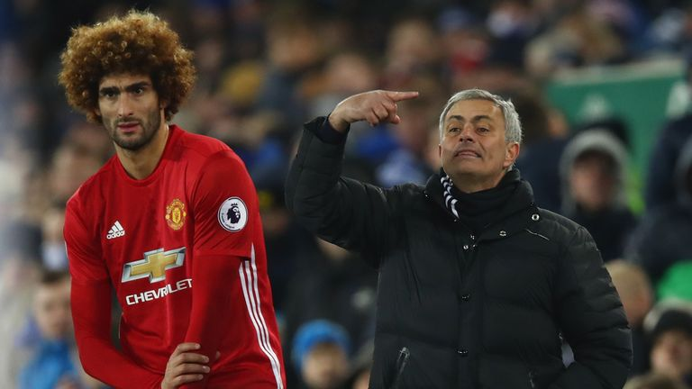 LIVERPOOL, ENGLAND - DECEMBER 04:  Jose Mourinho manager of Manchester United stands alongside his substitute Marouane Fellaini of Manchester United during