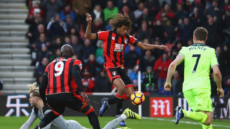 Loris Karius (left) spilled Steve Cook's shot, allowing Ake (centre) to tap home