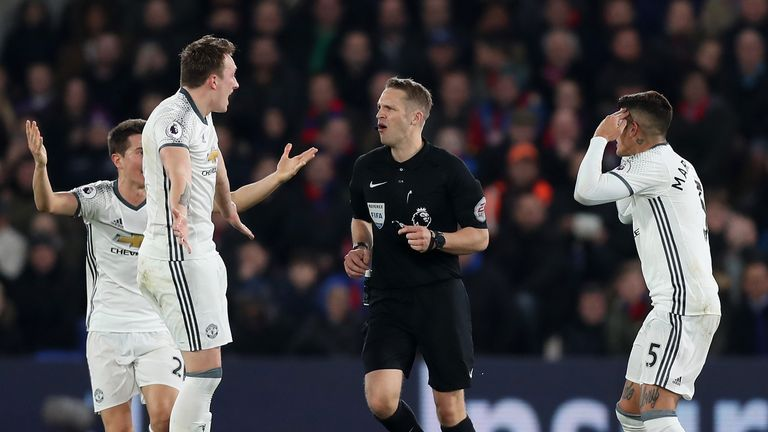 LONDON, ENGLAND - DECEMBER 14: Phil Jones of Manchester United (L) and Marcos Rojo of Manchester United (R) argue with the referee after there was no penal