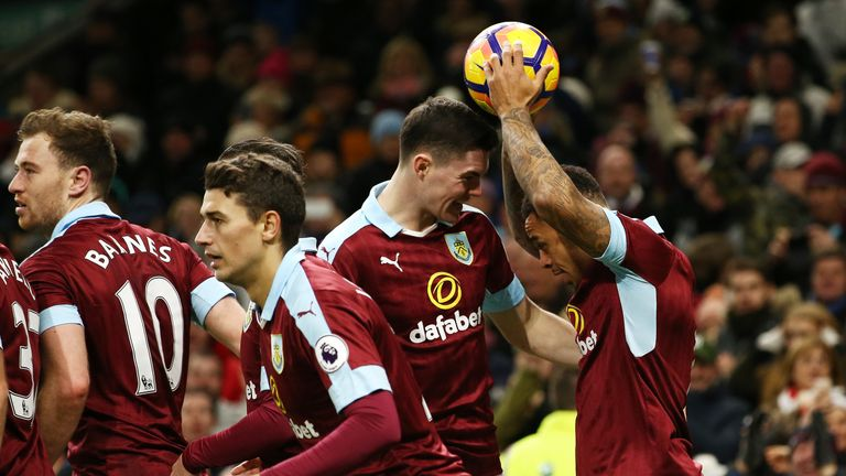 Andre Gray celebrates after scoring his and Burnley's third goal of the game