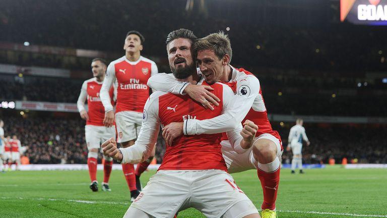 Olivier Giroud celebrates his goal with Arsenal team-mate Nacho Monreal
