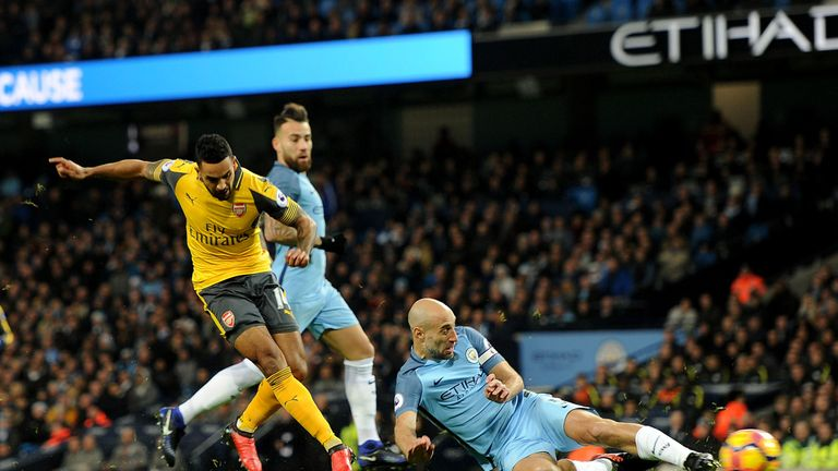 Theo Walcott puts Arsenal 1-0 up in the first half at the Etihad Stadium