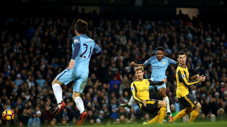 MANCHESTER, ENGLAND - DECEMBER 18: Raheem Sterling of Manchester City (R) scores his sides second goal during the Premier League match between Manchester C