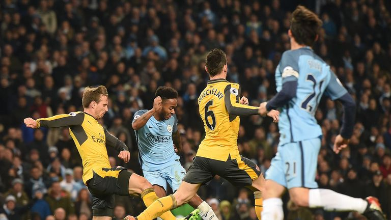Raheem Sterling's low strike gives Manchester City the lead at the Etihad Stadium