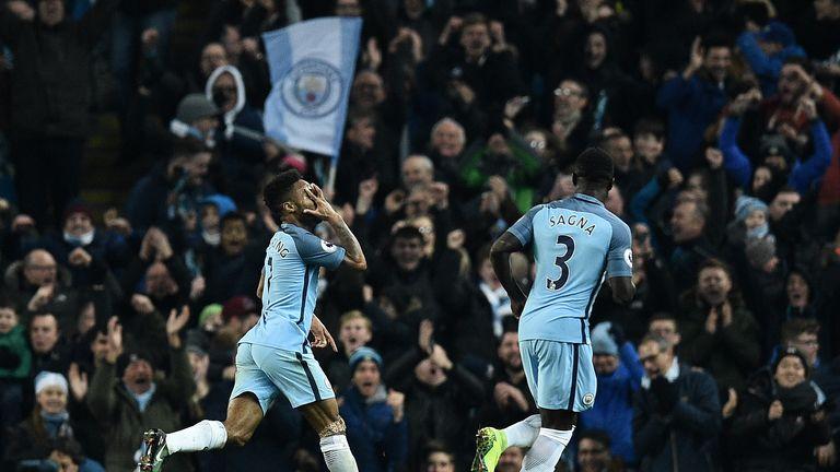 Raheem Sterling celebrates scoring Man City's second goal