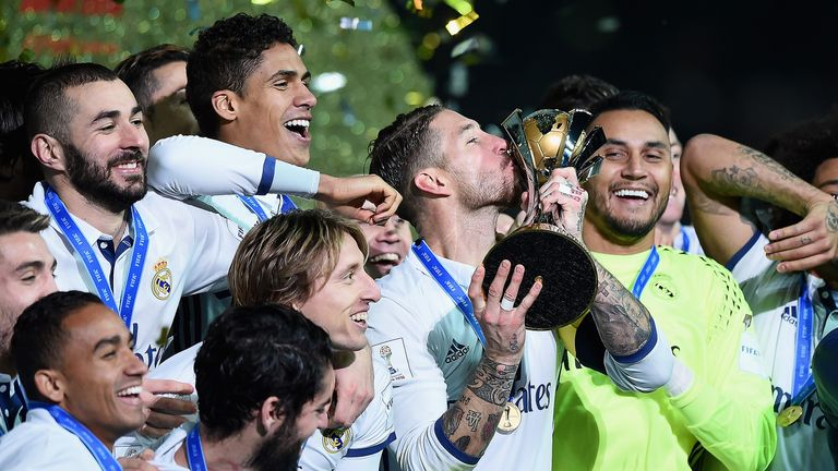 Sergio Ramos kisses the trophy as Real Madrid celebrate winning the FIFA Club World Cup
