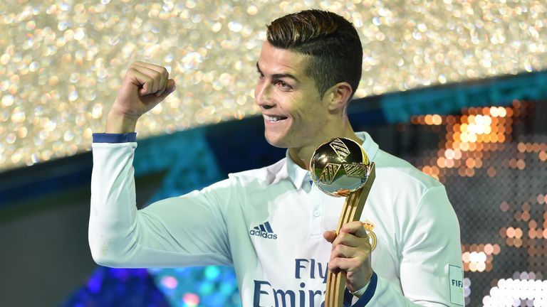 Cristiano Ronaldo receives the Golden Ball trophy after winning the Club World Cup