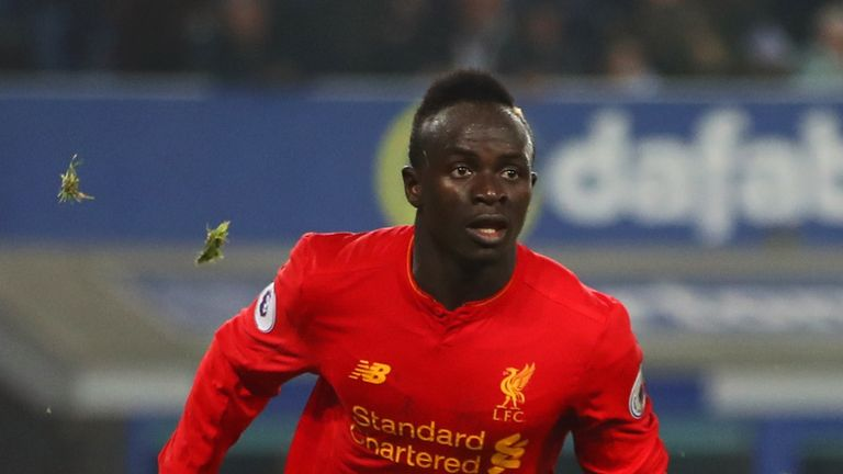 Sadio Mane of Liverpool celebrates as he scores their first goal during the Premier League match between Everton and Liverpool