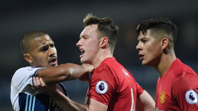 WEST BROMWICH, ENGLAND - DECEMBER 17:  Jose Salomon Rondon of West Bromwich Albion (L) and Phil Jones of Manchester United (C) clash during the Premier Lea