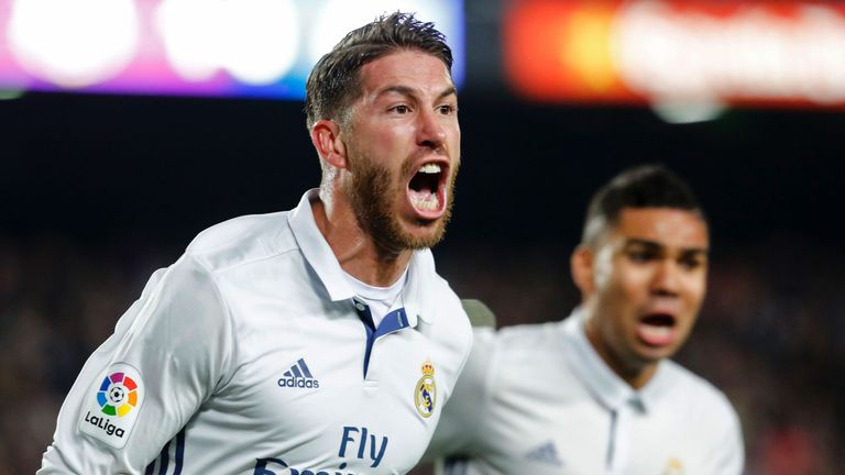 Real Madrid's defender Sergio Ramos celebrates after scoring the equalizer during the Spanish league football match FC Barcelona vs Real Madrid CF at the C
