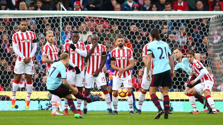 Scott Arfield attempts to score from a free-kick against Stoke for Burnley