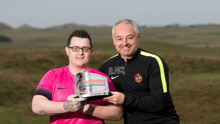 Dundee Utd fan Tommy McKay receives goal of the mo nth award for Terrors boss Ray McKinnon