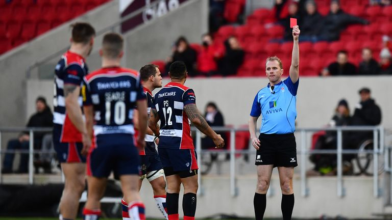 Tusi Pisi is shown a red card by Wayne Barnes for his tackle on Jamie Shillcock