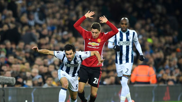 Claudio Yacob of West Brom Albion (L) is fouled by Man United's Ander Herrera