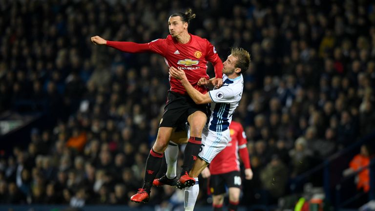 WEST BROMWICH, ENGLAND - DECEMBER 17:  Zlatan Ibrahimovic of Manchester United (L) and Craig Dawson of West Bromwich Albion (R) clash during the Premier Le