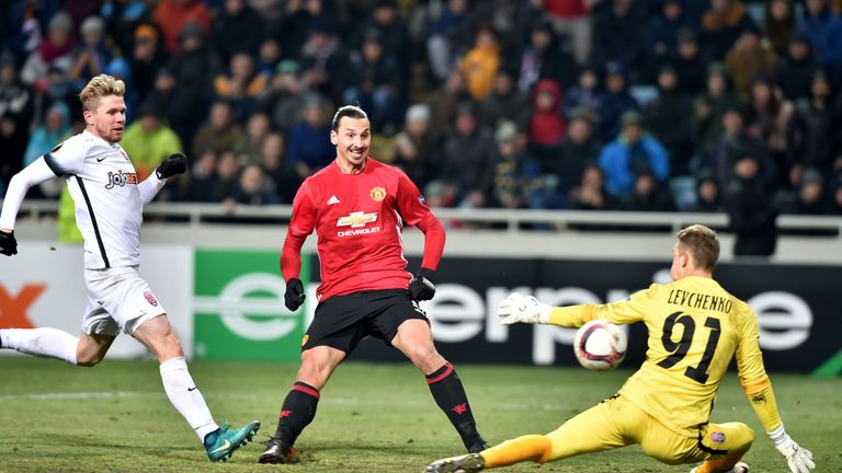 Manchester United's Swedish forward Zlatan Ibrahimovic (C) kicks to score a goal against Zorya Luhansk's Ukrainian goalkeeper Igor Levchenko during the UEF