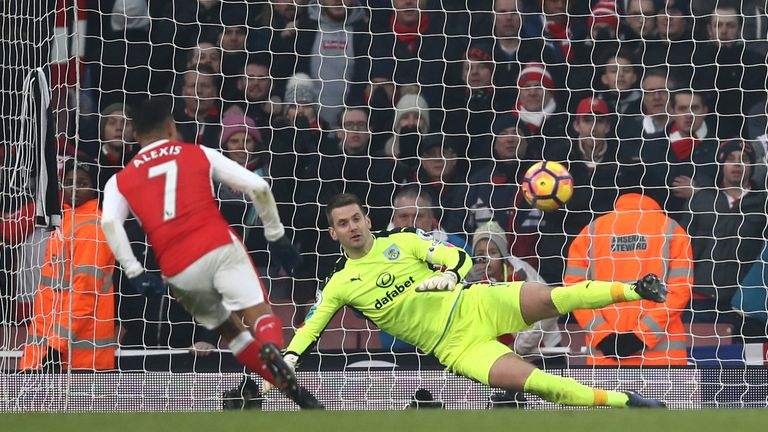 Alexis Sanchez of Arsenal converts the penalty to score his team's second goal during the Premier League match v Burnley