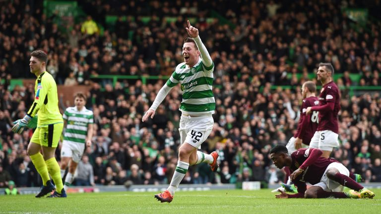 Callum McGregor wheels away in celebration after opening the scoring against Hearts