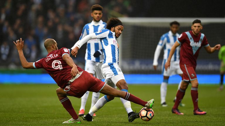 HUDDERSFIELD, ENGLAND - JANUARY 07 2017:  Isaiah Brown of Huddersfield is tackled by Rigino Cicilia of Port Vale during an FA Cup Third Round match