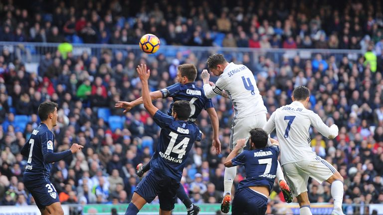 Sergio Ramos leapt above Malaga's defence to score the game's opening goal
